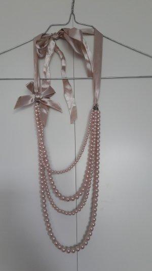 Lange Perlenkette zum Binden rosa mit Schleife
