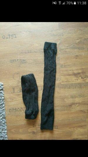 Lange schwarze Stulpen