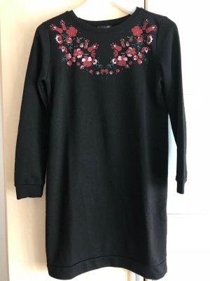 Langer Pullover mit Blumendruck