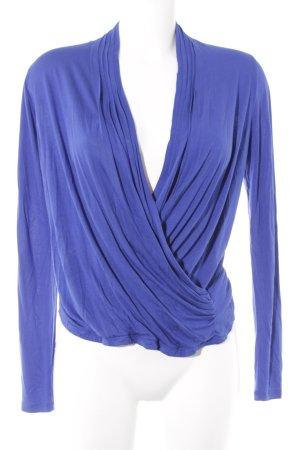 Laurèl Camisa cruzada azul look casual