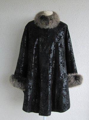 Poncho negro Cuero
