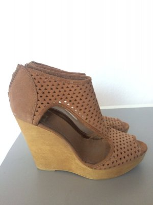 Lederwedges, Cutouts