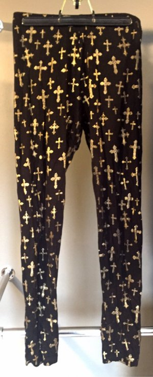 Leggings mit Kreuzprint in Gold