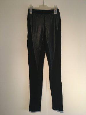 Leggings mit Lederapplikationen in Schwarz