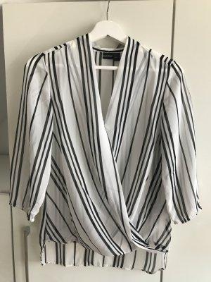 Blusa cruzada blanco-negro