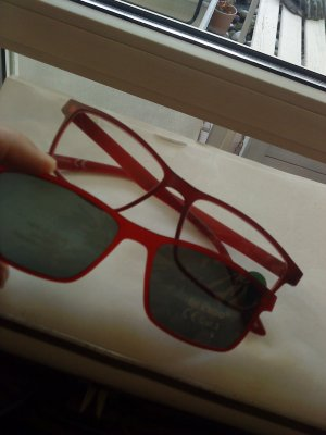 Glasses dark red synthetic material