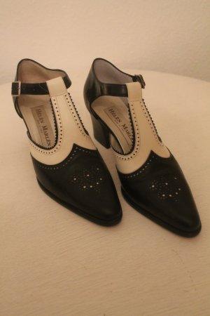 Zapatos de tacón con barra en T negro-blanco Cuero