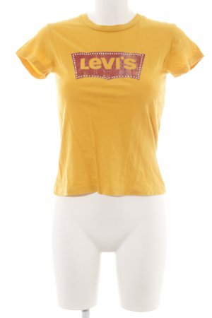 Levi's Camiseta amarillo pálido letras impresas look casual