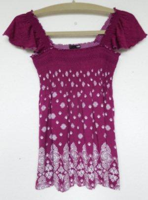 Lila Shirt mit weißem Muster von H&M