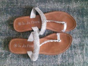 Sandalias de tacón con talón descubierto color plata Cuero