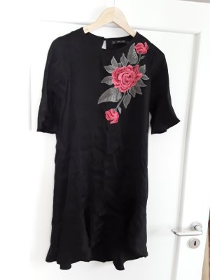 little black dress with flower twist