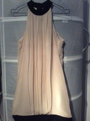 Locker geschnittenes Kleid in Creme mit schwarzem Bund