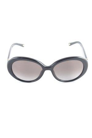 Loewe ovale Sonnenbrille schwarz-goldfarben Blumenmuster Glitzer-Optik