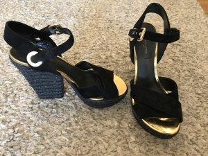 Louis Vuitton Pumps met sleehak goud-zwart