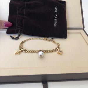 Louis Vuitton Bracelet blanc cassé-doré