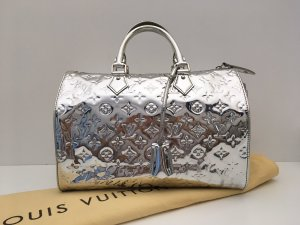 Louis Vuitton Bolso barrel color plata Fibra sintética