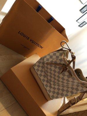 Louis Vuitton Sac seau or rose-blanc