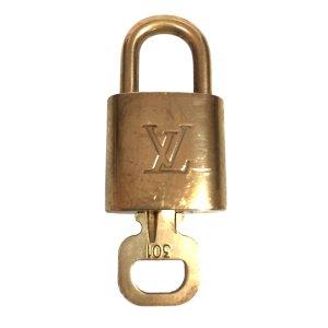 Louis Vuitton Porte-clés doré-bronze métal