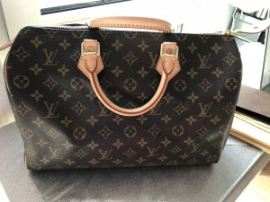 Louis Vuitton Bolso barrel color bronce