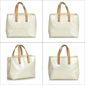 Louis Vuitton Sac fourre-tout blanc faux cuir