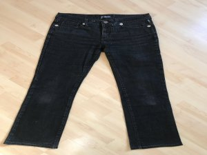 Lowrise dunkle Versace-Jeans mit Schlag