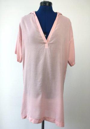 Camisa tipo túnica rosa claro