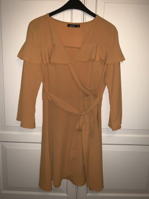 Vestido estilo flounce naranja dorado