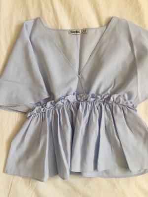 Lustige Bluse mit Raffung in der Taille