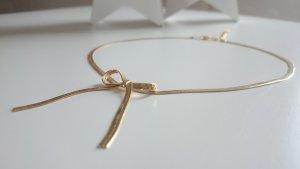 mädchenhafte goldfarbene Schlangenkette mit Schleifchen