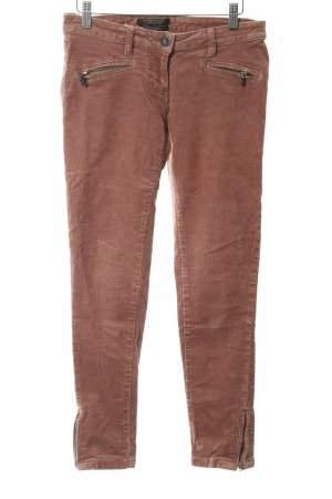 Maison Scotch Pantalón de pana rosa look casual