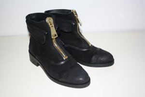 Boots black-gold-colored leather