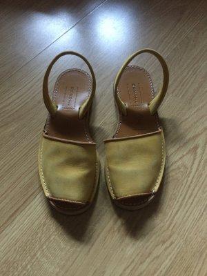 Sandalo con cinturino giallo scuro Pelle