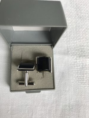 Bouton argenté-noir métal