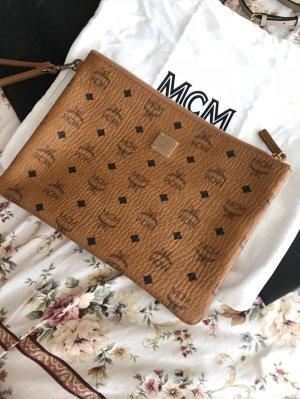 mcm stark top zip medium pouch ipad bag cognac