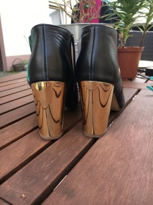 Mellow Yellow Booties mit goldenem Absatz