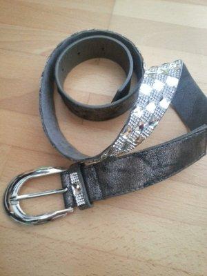 Cinturón de pinchos color plata
