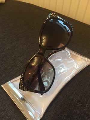 Mexx Sonnenbrille mit goldenen Nieten