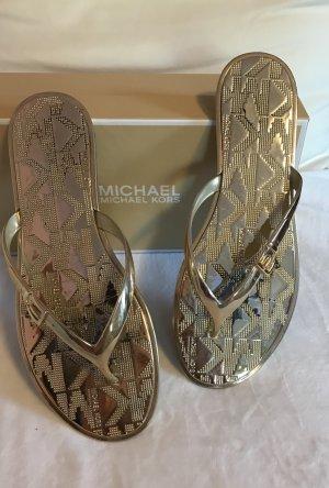 Michael Kors Flip Flops in Gold