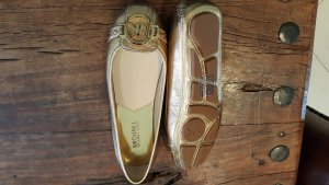 Michael Kors goldene Ballerinas