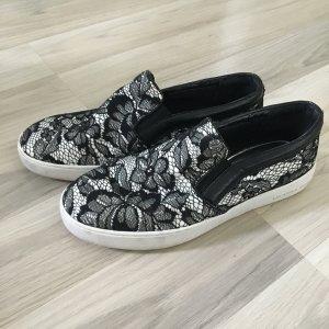 Michael Kors Sneaker Slip On Slip Ons Schuhe schwarz weiß Spitze