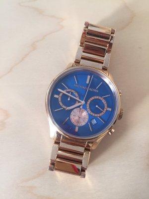 Michael Kors Uhr, blau und Gold.