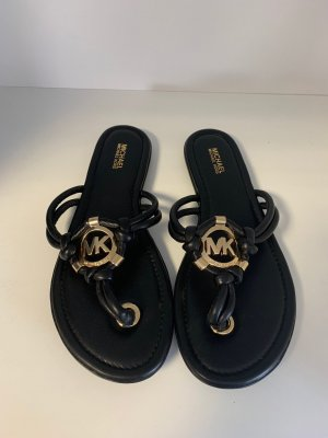 Michael Kors Sandalo toe-post nero-oro Pelle