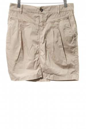Minifalda beige look casual
