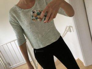 Mintgrüner Pullover mit Nieten