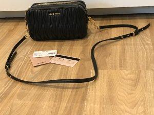 Miu Miu Gekruiste tas zwart-goud