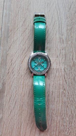 Moderne Guess Armbanduhr in schickem türkis mit Swarovski Kristallen ums Gehäuse