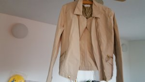 Moderne kurze Damenjacke beige farbig, ideal für Herbst