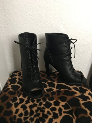 moderne schwarze Schnür Stiefelette vorne offen