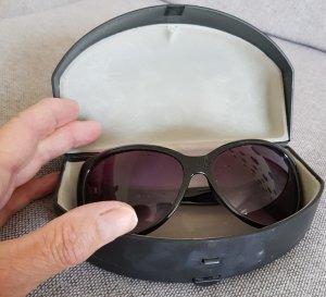 Guess Occhiale da sole ovale nero