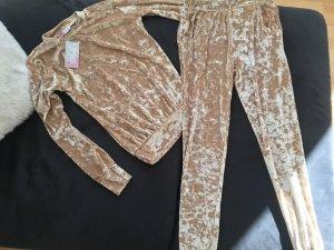 Abbigliamento sportivo oro